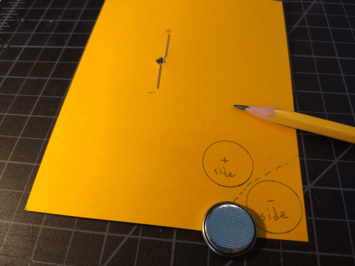 Draw where you'll put the battery. Use an actual battery to trace, so you'll how big you'll need the fold to be.