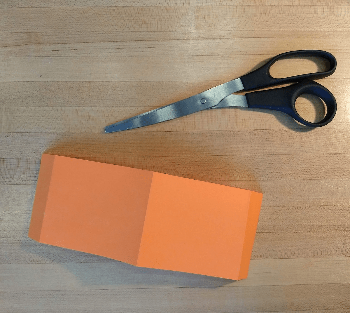 Cut out a long slip of paper and fold it as shown above.