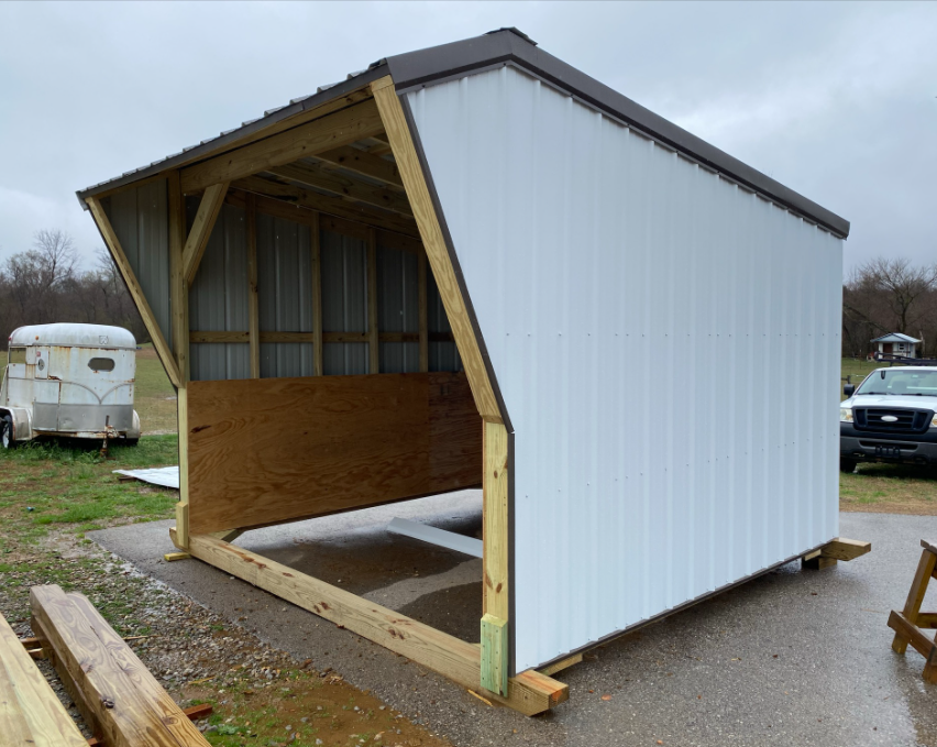 12' x 12', bright white sides and bronze roof and trim.