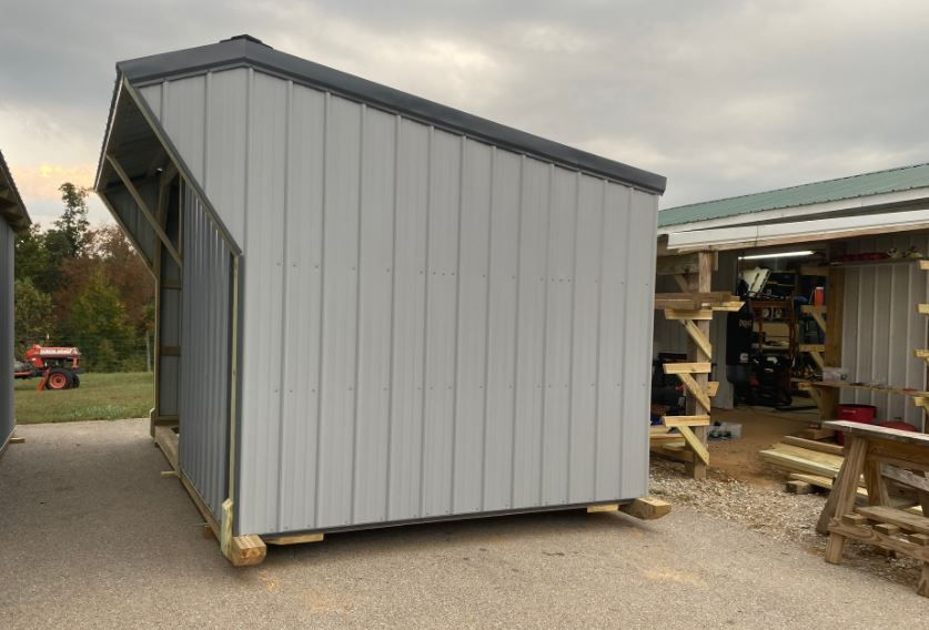 10' x 16' with half enclosed front.