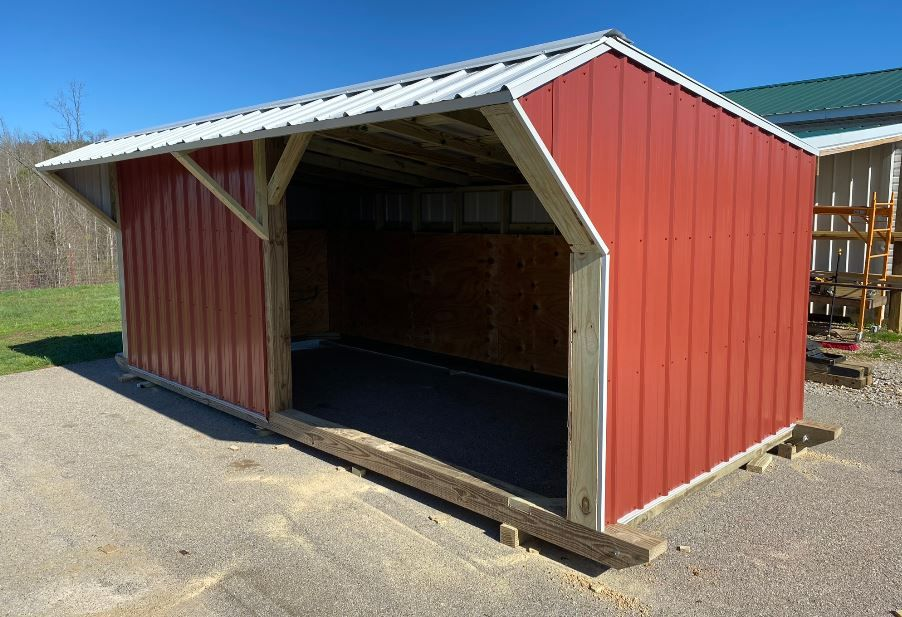 Short 8' x 18' barn red sides with white trim and roof.