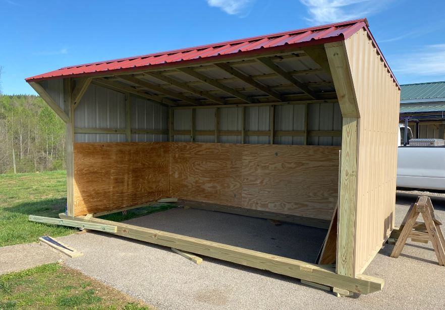 8' x 15' tan with barn red roof.