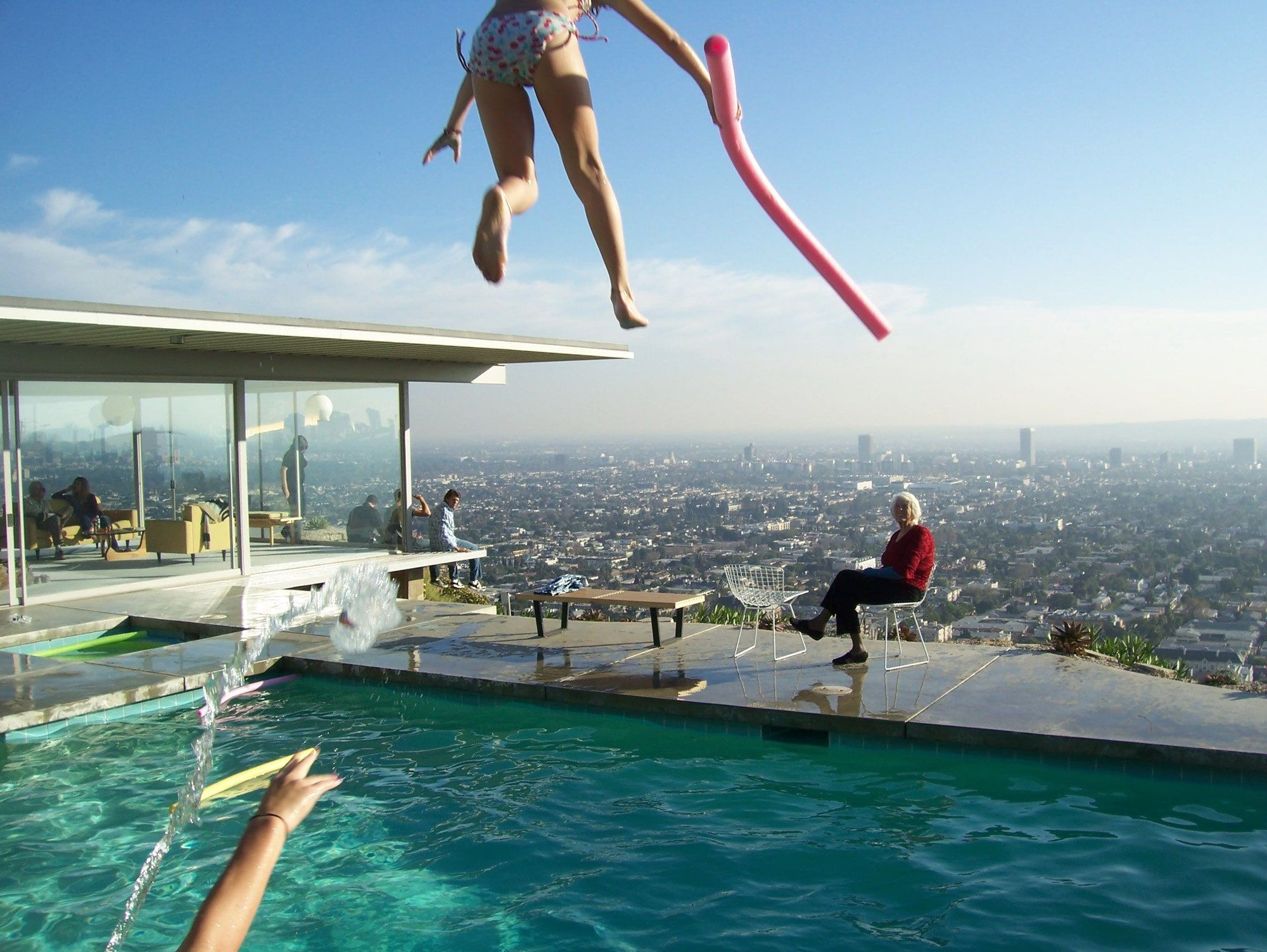 Carlotta Stahl and her son Bruce watch his daughter Sara jump off the roof of the house into the pool, July 2009. Courtesy Stahl Family Archive.