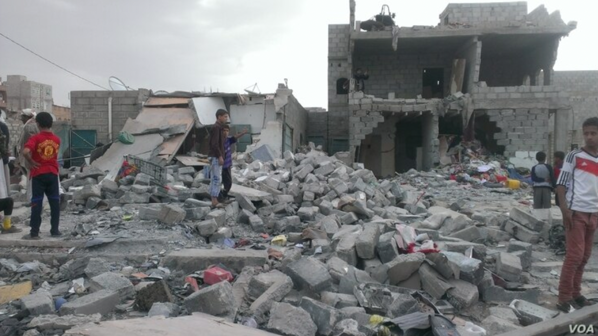 Yemeni civilians go through the rubble of a home destroyed by Saudi airstrikes in 2015, very possibly using bombs built and supplied by the United States of America. Via