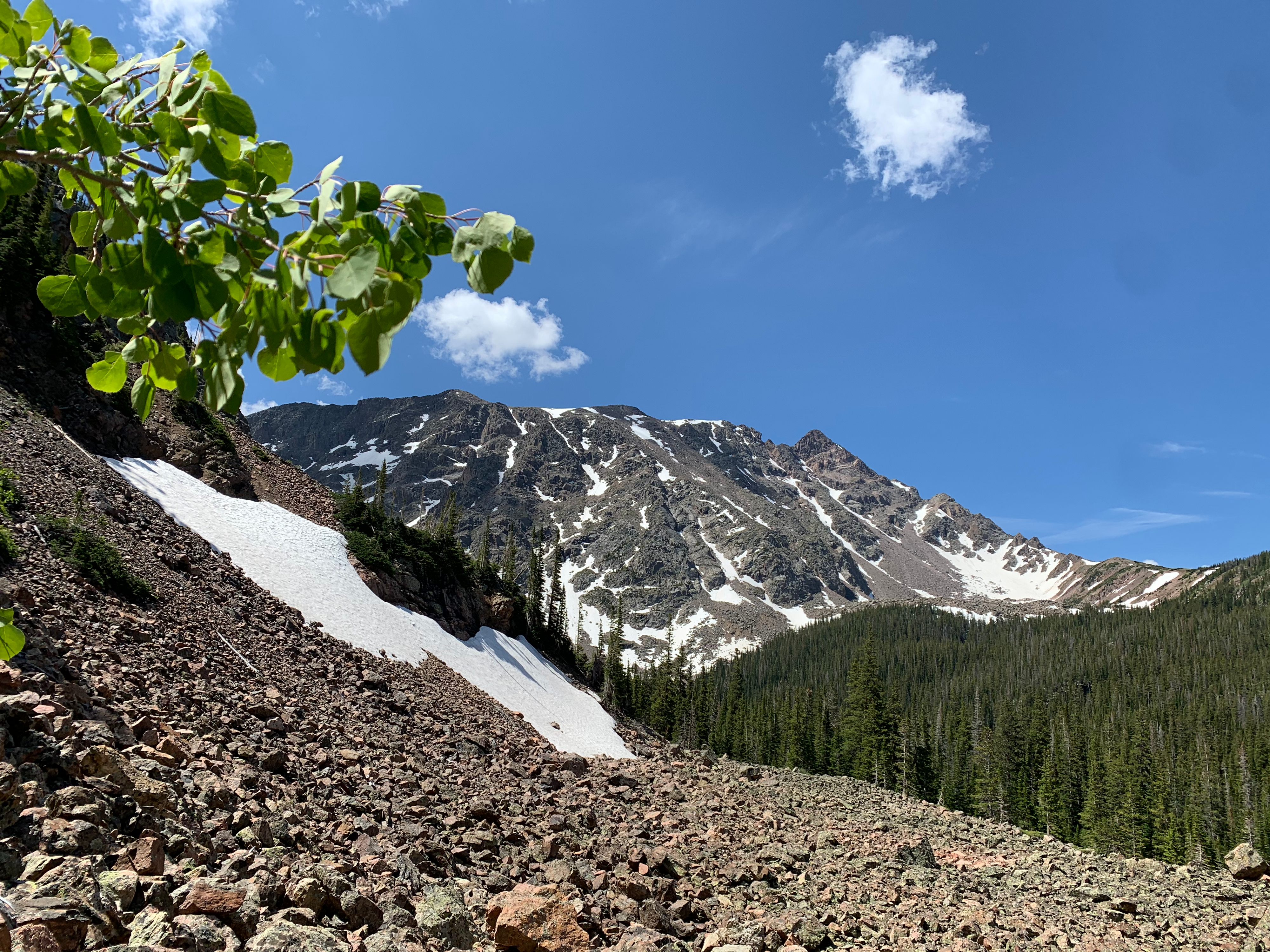 Looking up at the Eagles Nest, the striped peak on the far right of the ridgeline pictured here. This was the first view we had of the Nest while approaching the basin during a backpacking trip earlier in the 2020 summer season.