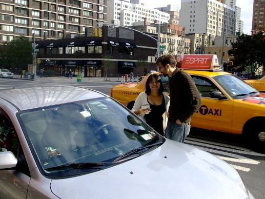 Mike and Su getting ready to take out a rental car for one of our tests.